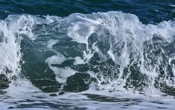 Coastal sea/ocean crashing wave with foam on its top. Coastal transparent sea/ocean crashing wave with foam on its top stock images