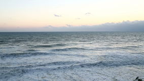 Coastal sea waves against the background of the twilight sky. Coastal sea waves against the background of the twilight sky beat against the shore stock video footage
