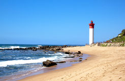 Coastal Seascape With Red and White lighthouse Royalty Free Stock Images
