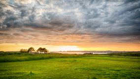Coastal Landscape at Sunset. Coastal seaside meadow at Sunset in Brittany region of France. This is a HDR image of the coastline in northwestern France with a royalty free stock image