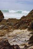 Coastal shoreline. Rocky shoreline with crashing waves at background Stock Images