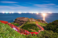 Coastal Shrine in Japan. Motonosumi Shrine with fishing boats on the Sea of Japan at night Stock Image