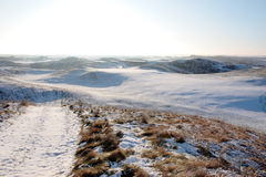 Coastal snow covered links golf course Stock Photo