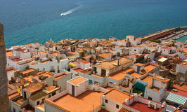 Coastal Spanish town. View of the sea and the roofs of the Spanish seaside town Stock Image