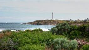 Cape leeuwin lighthouse and coastal wildflowers in west australia. Coastal spring wildflowers and west australia`s cape leeuwin lighthouse royalty free stock photo