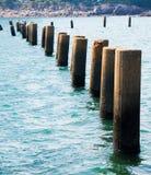 Coastal. Stone Spile,in the sea Stock Image