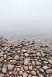 Coastal stones on Saimaa lake. In foggy morning royalty free stock photos