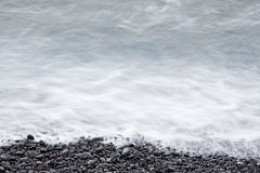 Coastal stones and sea surf Royalty Free Stock Images