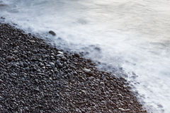 Coastal stones and sea surf Stock Image