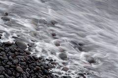 Coastal stones and  and sea waves Stock Photos