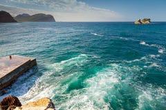 Coastal stones and small pier. Adriatic Sea Stock Images