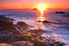 Coastal Sunrise with golden sea Royalty Free Stock Photography