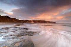 Beautiful Coastal Sunrise. Coastal Sunrise at Robin Hoods Bay, North Yorkshire, England stock photo