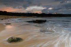 Sunrise at Malabar Beach, Sydney. Coastal Sunrise in Sydney with water flowing up Malabar beach Royalty Free Stock Image