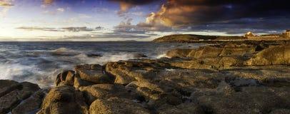 Coastal Sunset. Beautiful Seascape sunset taking from a Cumbria Beach royalty free stock photography