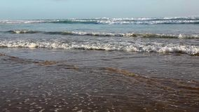 Coastal Tide Coming In. With waves and sand stock footage