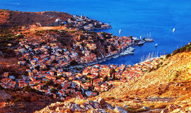 Coastal town. Europe, Greece, Symi, beautiful cityscape, Mediterranean sea, many little houses, panoramic landscape, travel concept stock images