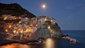 Coastal town illuminated at night