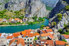 Coastal town of Omis surrounded with mountains in Croatia Stock Photos