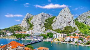 Coastal town of Omis surrounded with mountains in Croatia Stock Image