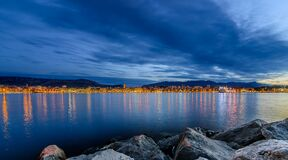 Coastal town reflecting in waterfront Stock Images