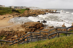 Coastal Town Wooden Steps and Concrete Jetty in Storm Stock Photos