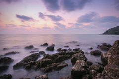 Coastal twilight scene, Long Exposure of rocks and waves at suns Royalty Free Stock Image