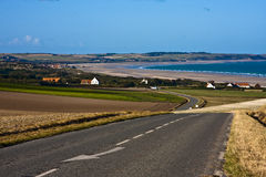 Coastal view. View of seaside resort in france from road with large sandy beach and breaking waves Stock Image