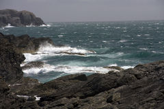 Coastal view around Anglesey. And roughs seas on rocky coast line Stock Photo