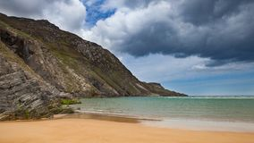 Coastal view with beach and rocks. And clouded sky somewhere in ireland stock image