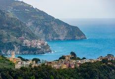 Coastal view of famous travel landmark destinations Corniglia and Manarola, small mediterranean old sea town, Cinque Royalty Free Stock Photos