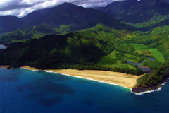 A coastal view from mid-air. A high view of the Hawaiian coast Royalty Free Stock Image