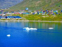 A coastal view of Narsaq, Greenland with ice bergs stock photography