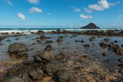 Coastal view of the shore line with its black volcanic rocks and Royalty Free Stock Photography
