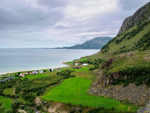 Coastal village in a cloudy day with farms along the coast Royalty Free Stock Photos