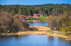 Coastal village with red wooden houses Royalty Free Stock Image