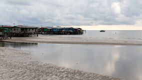 Coastal Village Sea Low Tide Landscape Poverty Dilapidated Homes stock photos