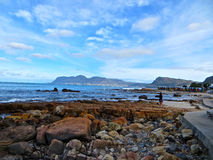 Coastal Walkway. Rocky beach road along the southern western coast of False Bay, Cape Town, South Africa royalty free stock image