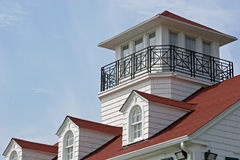 Coastal Watch. Roofline on coastal cottage Stock Image