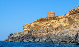 Coastal Watch Tower. From the sea in the Blue Grotto in Malta Stock Photos