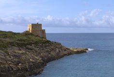 Coastal Watchtower. Watchtower built in 1650 by the Order of the Knights of St John to guard the entrance to the bay in Xlendi, Gozo royalty free stock images