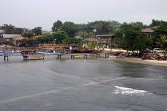 Coastal Waters Roatan. Beach area of Roatan Honduras. Dock and boats can be seen stock photo