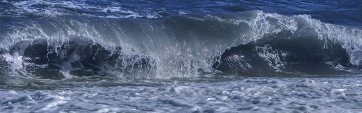 Coastal wave breaking at shoal. Coastal sea/ocean wave breaking at shoal stock image