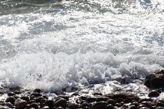 Coastal wave of sea pebbles Stock Photography