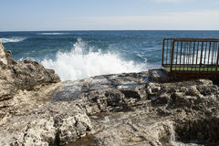 Coastal waves at Syracuse. In Sicily, Italy. rocks and waves Royalty Free Stock Photography
