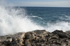 Coastal waves at Syracuse. Italy. rocks and waves. Off the coast of syracuse Royalty Free Stock Images