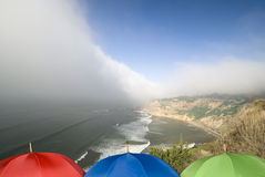Coastal weather front and umbrellas Stock Image