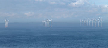 Coastal Wind Farm. Three Rows of Turbines on a Coastal Wind Farm Royalty Free Stock Image