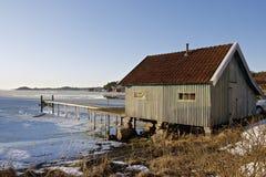 Coastal winter landscape. A fisherman's boathouse at Tjärnö on the Swedish west coast in the winter Royalty Free Stock Photography
