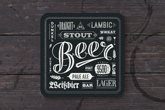 Coaster for beer with hand drawn lettering Royalty Free Stock Photos